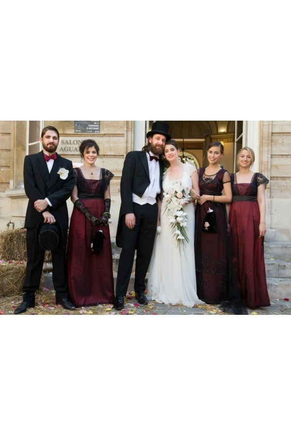 Bride and groom and bridesmaids in red Titanic dresses