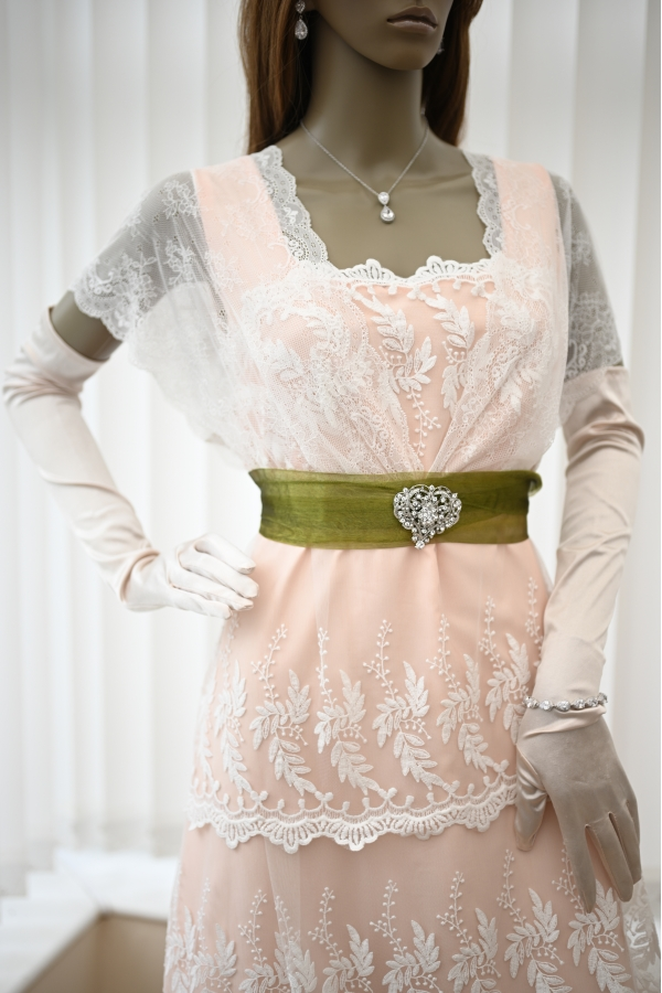 Top part of the lace Titanic dress in peach with green sash